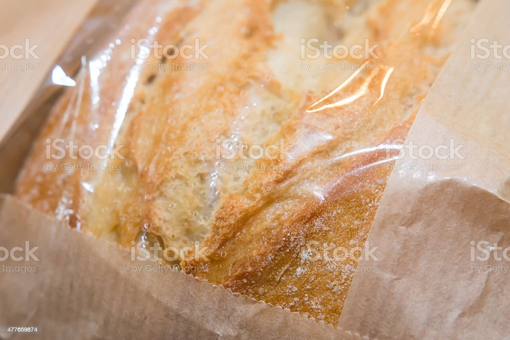 Bread in paper bag stock photo