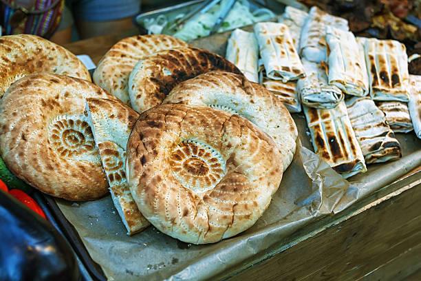 bread lavash at the street market. pita, chapati, tortilla, fatir - kräuterfaltenbrot stock-fotos und bilder
