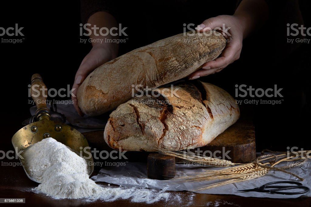 Bread Loaf In Baker Hands stock photo