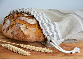 Bread loaf in reusable zero waste linen bread bag, close-up view