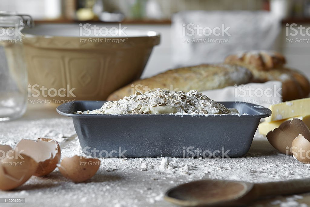 Bread loaves and dough in messy kitchen stock photo