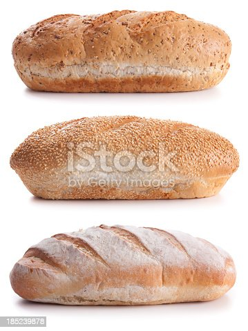 3 separate bread loaves, side view, isolated on white.