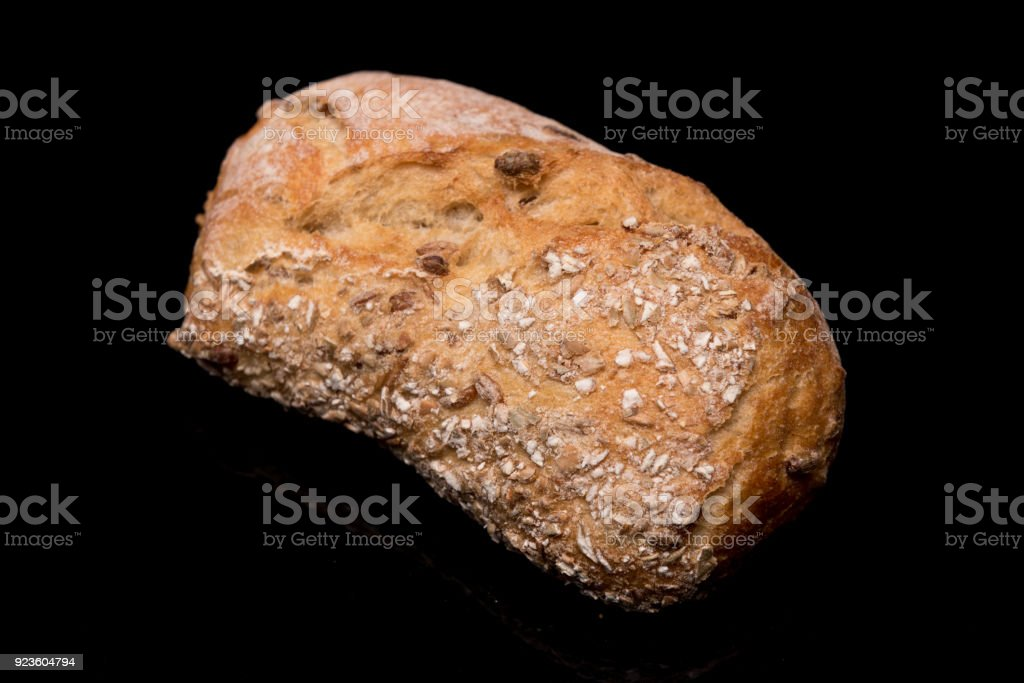 bread on a black background stock photo