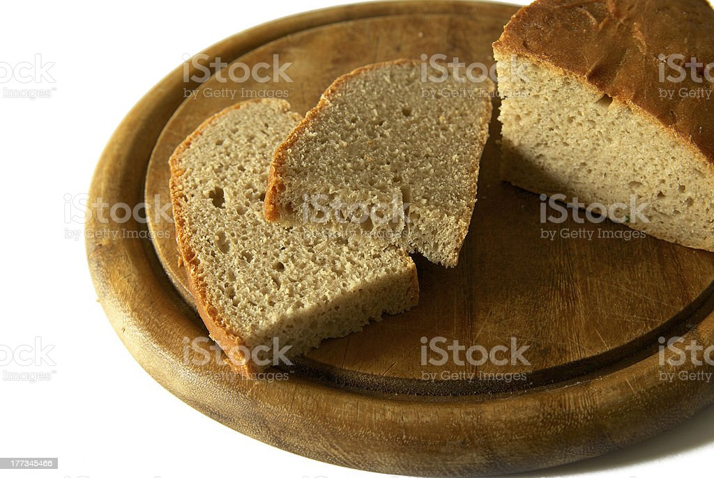 bread on a cutting board stock photo