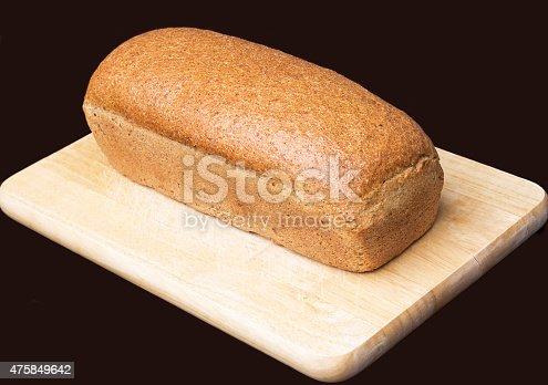 628409126istockphoto Bread on black background. 475849642