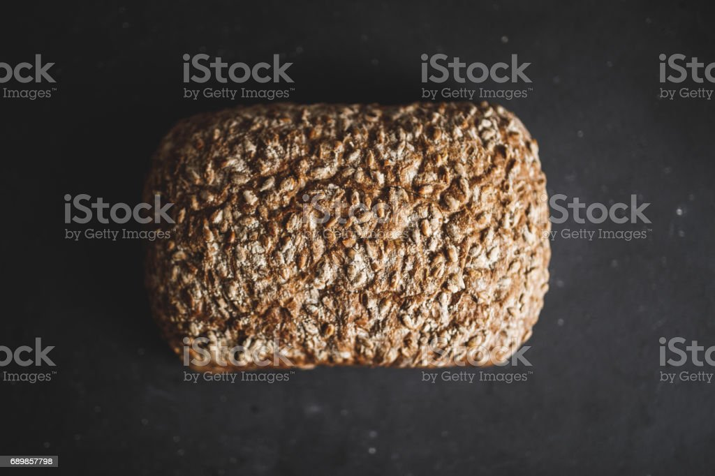 Bread on black table with flour stock photo