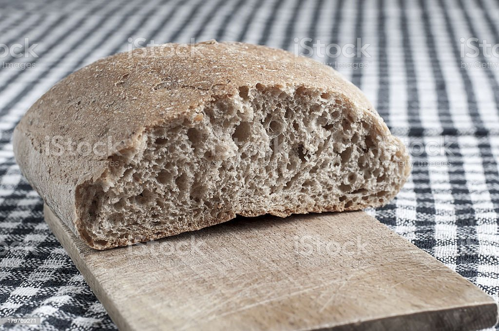bread on the cutting board royalty-free stock photo