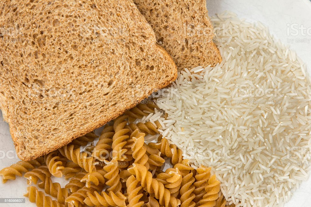 Bread, pasta and rice stock photo