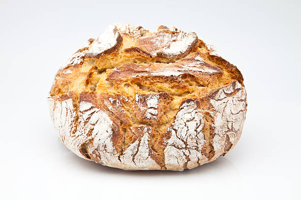 bread loaf of bread baked in wood oven round loaf stock pictures, royalty-free photos & images