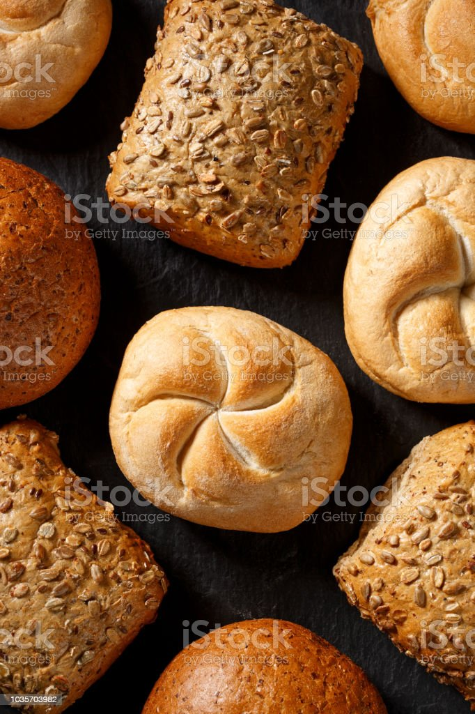 Bread rolls  on a black background stock photo