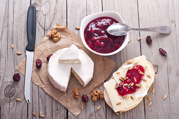 bread served with camembert and cranberry. - baked brie stock photos and pictures