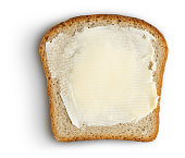 Bread slice with butter on white clipping path included. This file is cleaned and retouched.