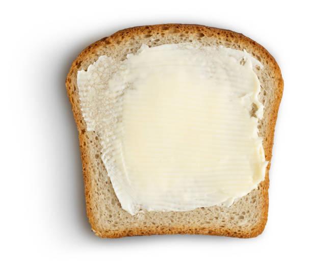 brood slice met boter op wit knippen pad opgenomen - boter stockfoto's en -beelden
