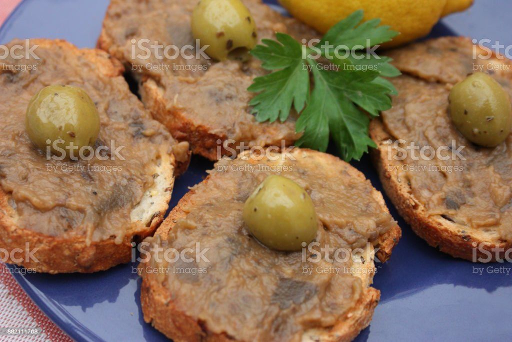 Bread slices with eggplant caviar stock photo
