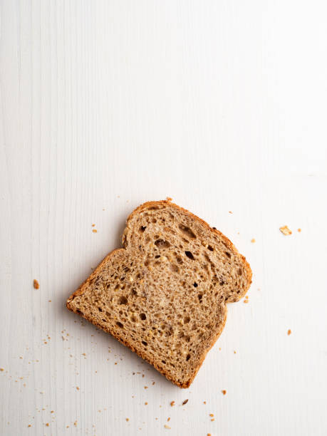 Bread slices,Multigrain bread slice Bread, Toasted Bread, Celebratory Toast, Slice of Food, White Background,food,Brown Bread whole wheat stock pictures, royalty-free photos & images