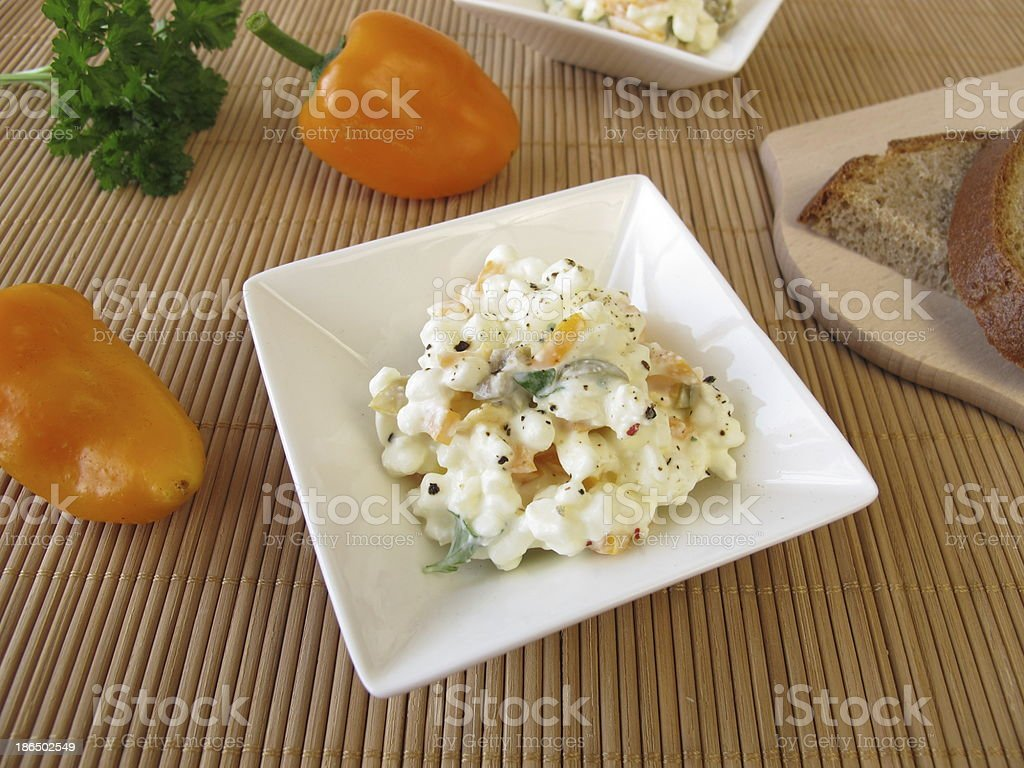 Bread spread with cottage cheese, olives and sweet peppers royalty-free stock photo