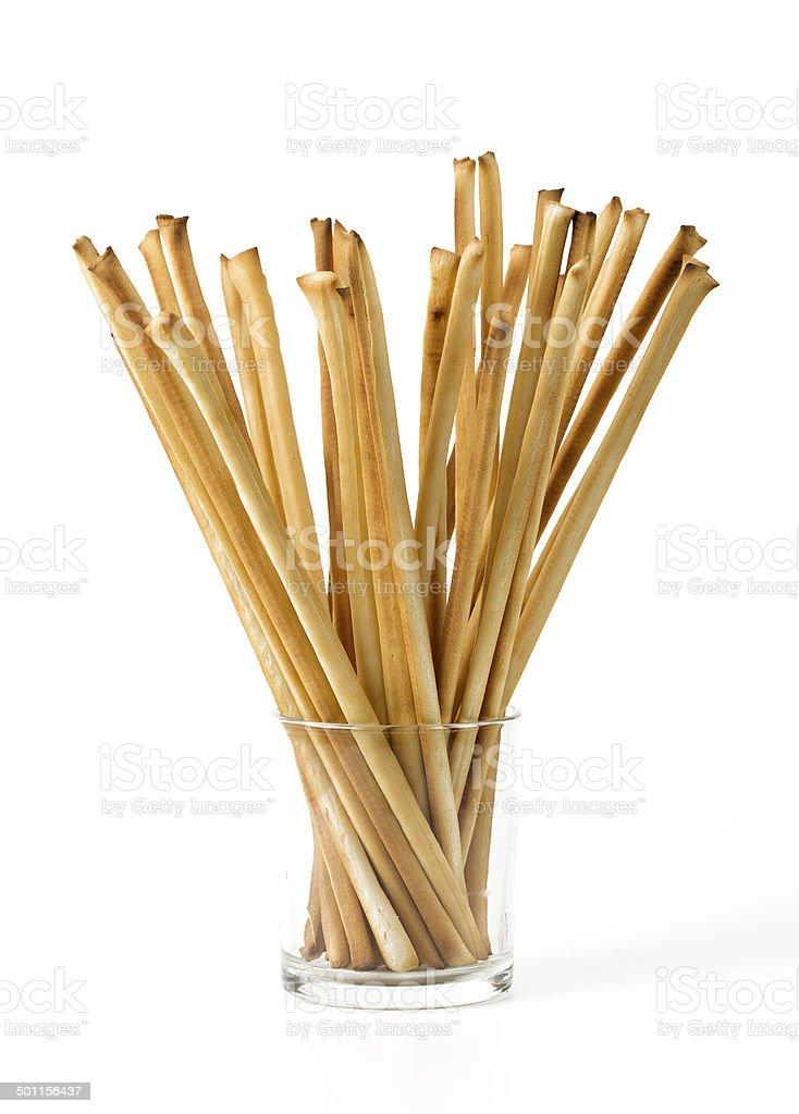 bread sticks in a glass over white stock photo