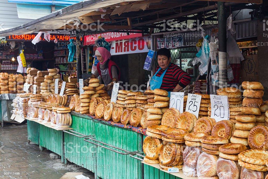 Bread vendors at Osh Bazaar stock photo