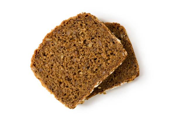 Tranches de pain blé entier isolés sur fond blanc - Photo