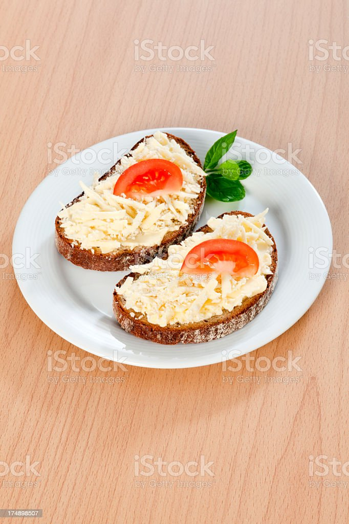 Bread with butter and grated cheese royalty-free stock photo