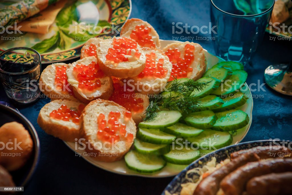 Bread with butter and red caviar stock photo