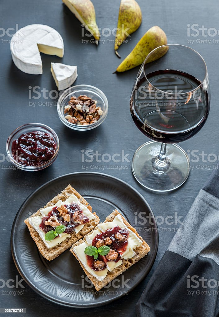 Bread with camembert cheese and jam stock photo