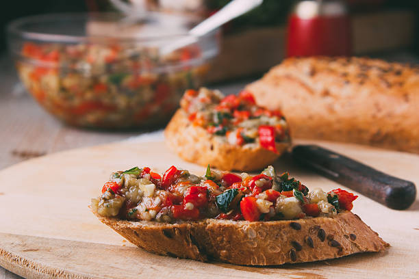 Bread with chutney, red pepper, tomato and eggplant stock photo