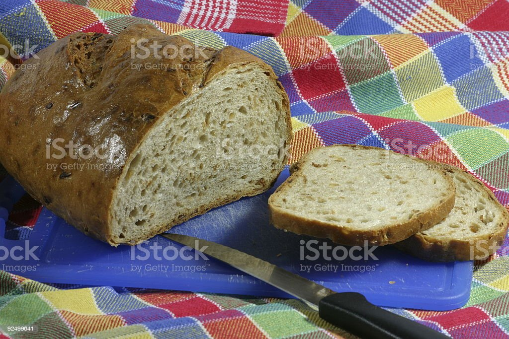 Bread with kitchen cloth and knife royalty-free stock photo
