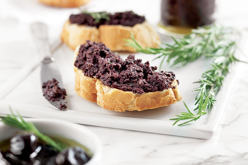 istock Bread with olive pate,olive puree,black olive Tapenade, 1083779414