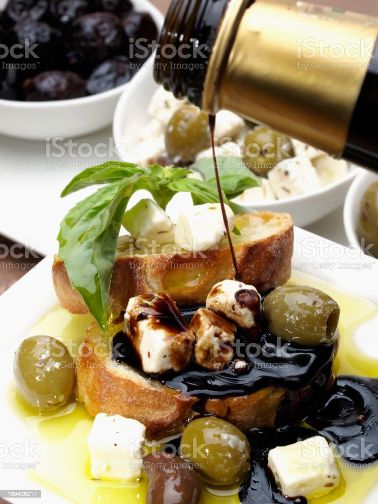 Bread with olives, cheese, balsamic vinegar and oil stock photo