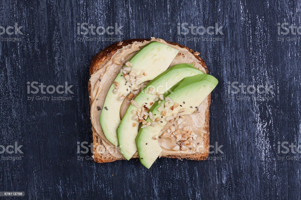 bread with peanut butter and avocado stock photo