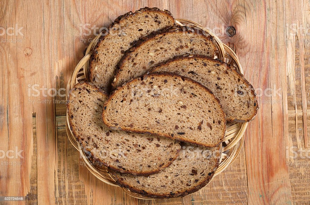 Bread with seeds in plate stock photo