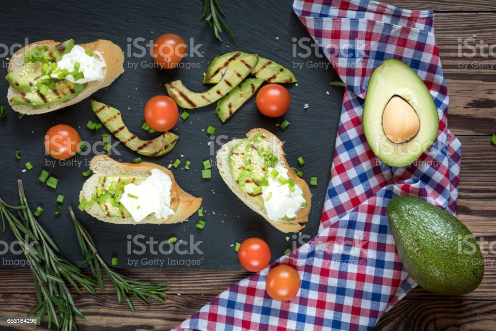 Bread with slices of avocado and cream cheese royalty-free stock photo