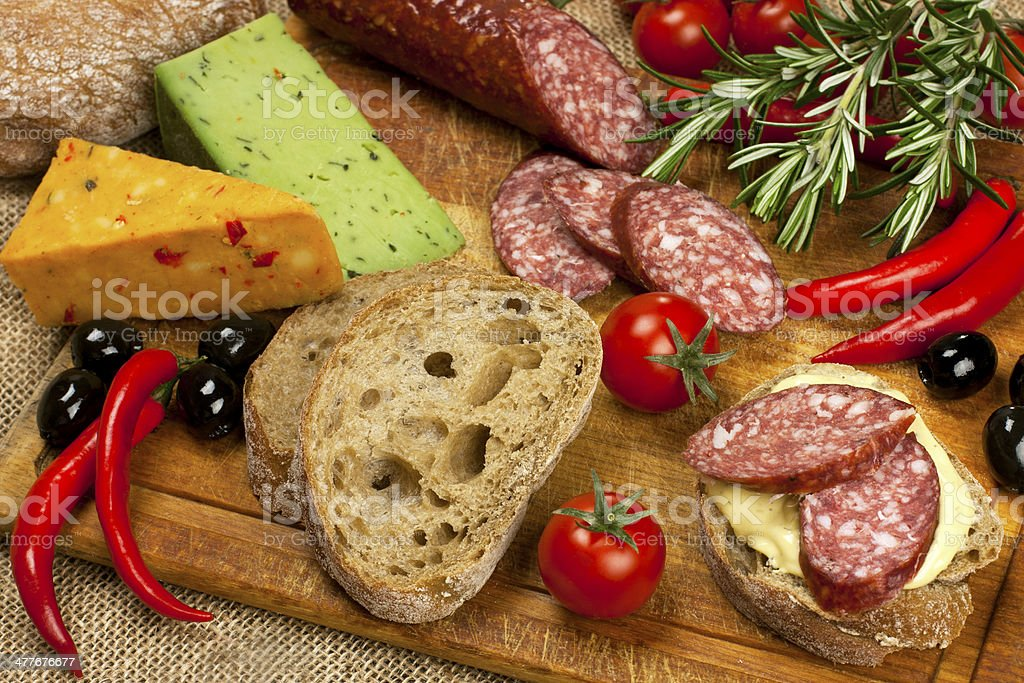 Bread with smoked salami and  cheese royalty-free stock photo