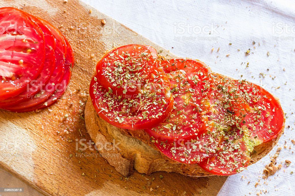 Bread with tomato and basil royalty-free stock photo