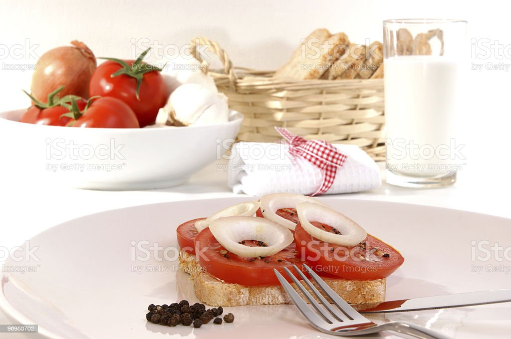Bread with tomato, cut in slices royalty-free stock photo