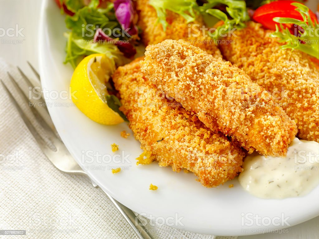 Breaded and Baked Fish Sticks with Tarter Sauce stock photo
