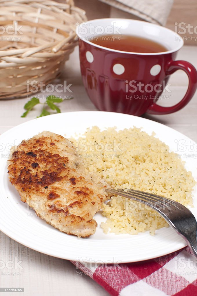 Breaded chicken cutlets with couscous royalty-free stock photo