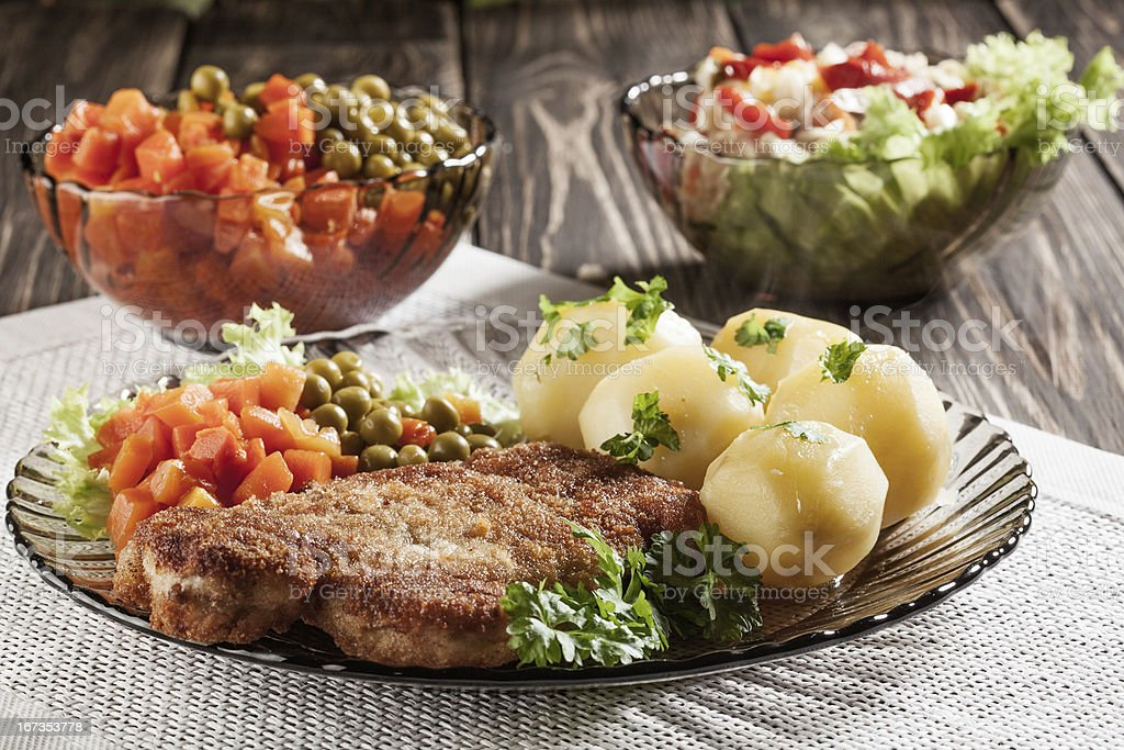 Breaded chop and potatoes. royalty-free stock photo