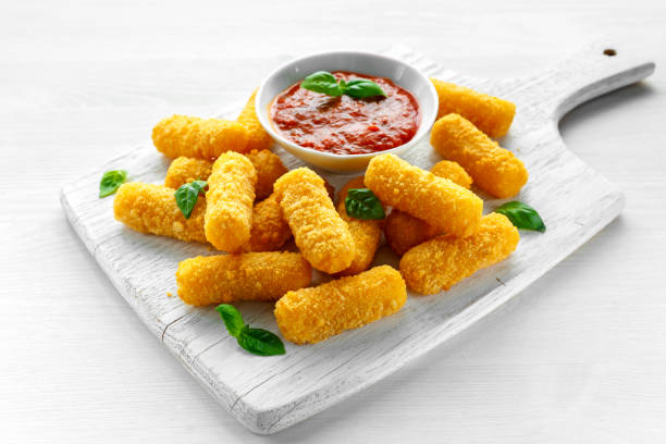 breaded mozzarella cheese sticks with tomato basil sauce - sticky stock pictures, royalty-free photos & images
