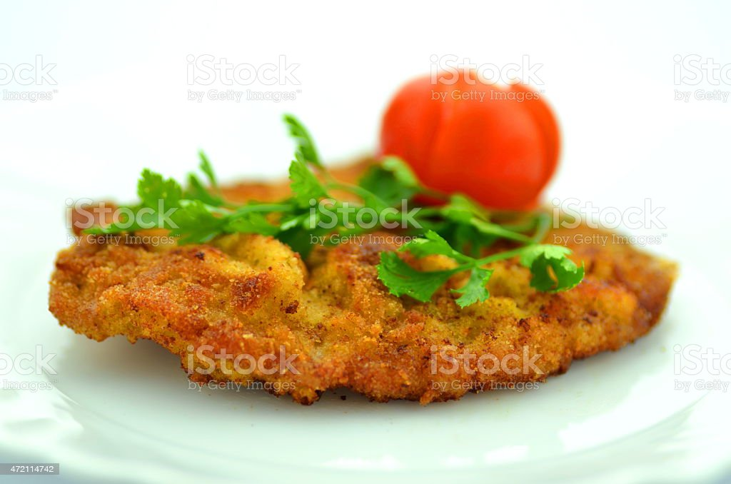 breaded pork chop on a plate stock photo