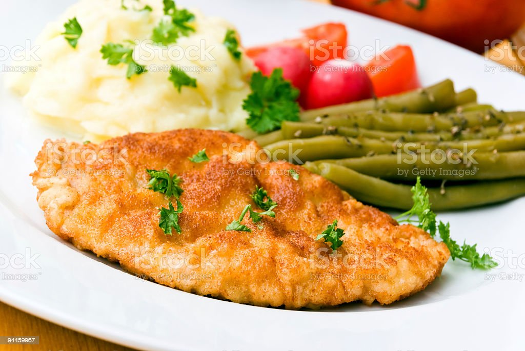 breaded pork chop with green beans royalty-free stock photo