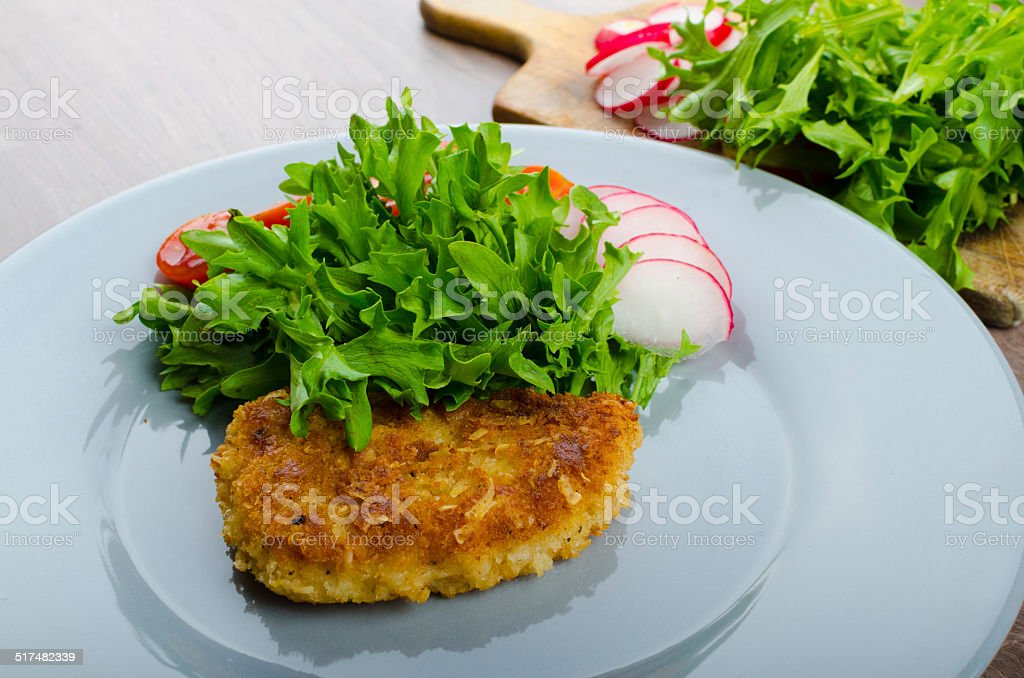 Breaded pork chops in Parmesan cheese stock photo