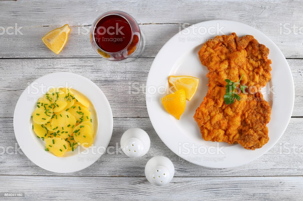 breaded veal cutlets with potato salad stock photo