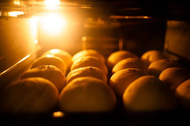 Breads baking in the oven stock photo