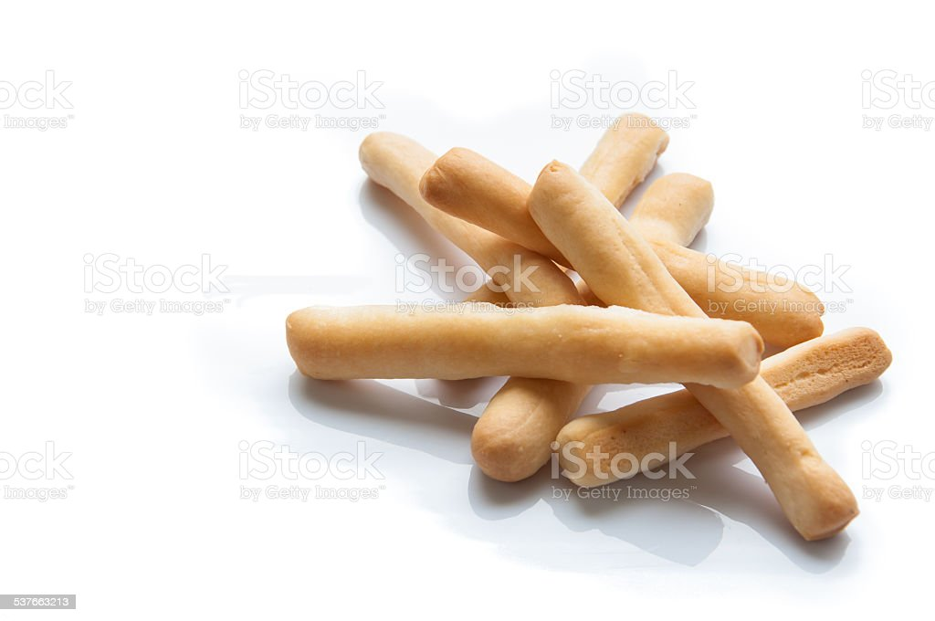 Breadsticks in napkin on wooden background. stock photo
