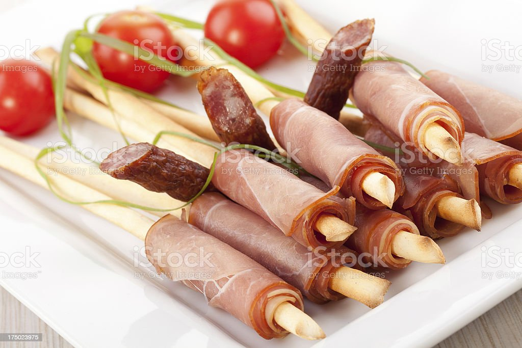 breadsticks with smoked ham royalty-free stock photo