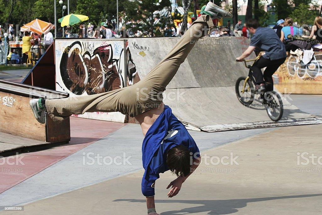 Break dancer and biker. royalty-free stock photo