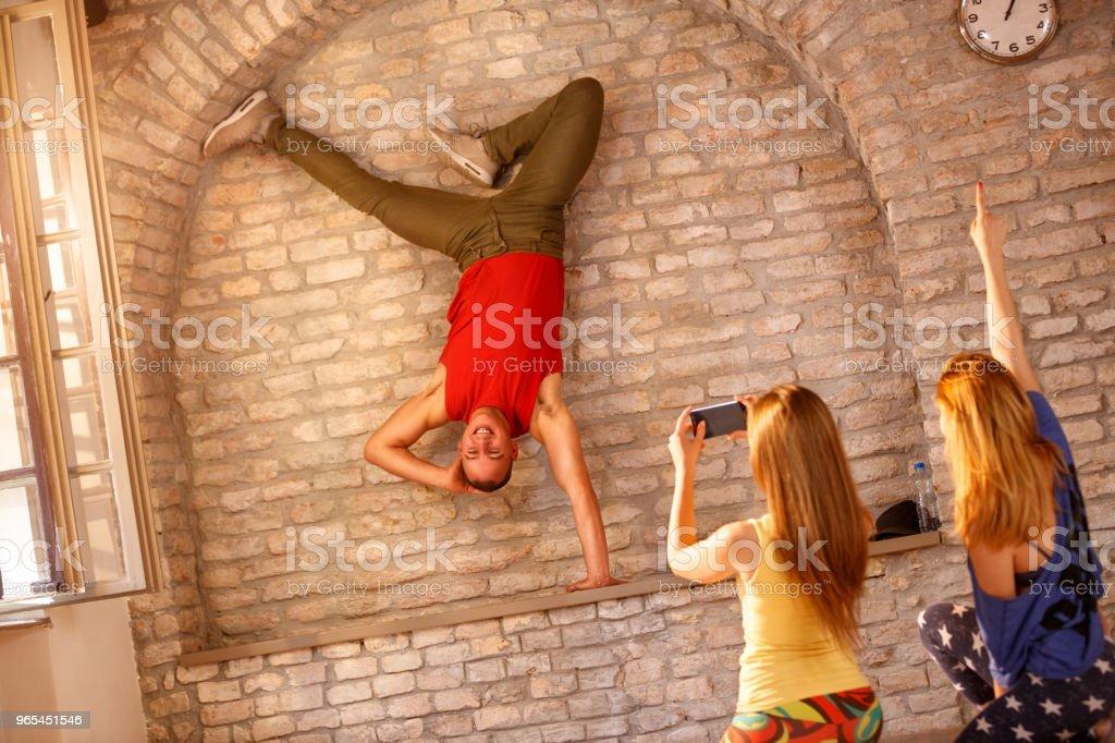 Break dancer doing one handed handstand royalty-free stock photo