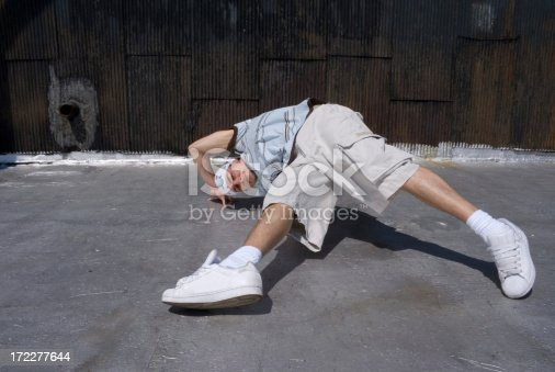 professional break dancer on a manhattan rooftop